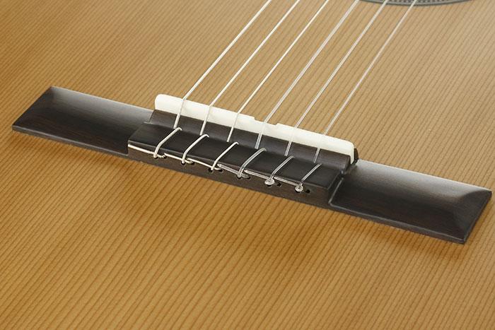 Puente de guitarra clásica de 12 agujeros