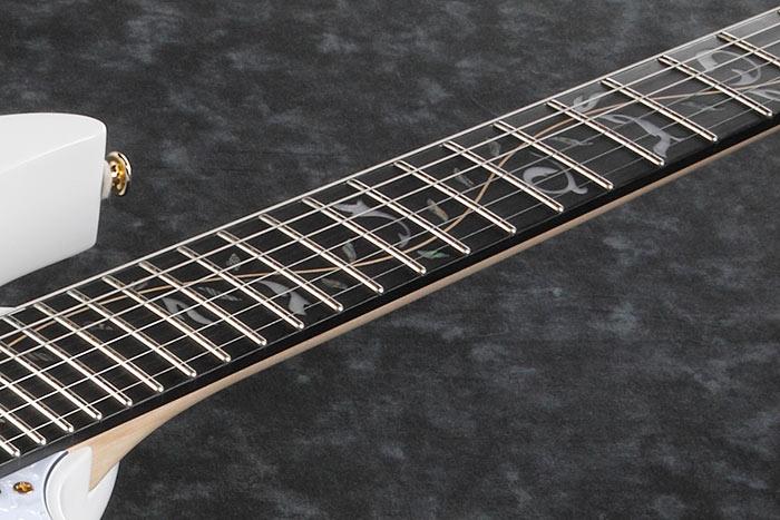 Ebony fretboard w/Gold Step off-set dot inlay